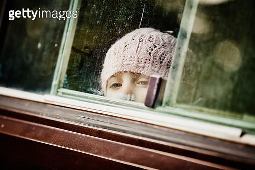 Young girl looking out window of camper van - gettyimageskorea