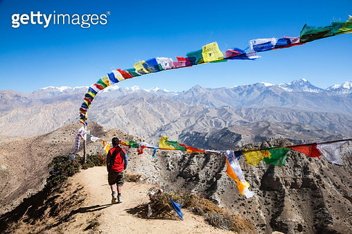 Hiker relaxing on mountain high pass, Upper Mustang, Nepal - gettyimageskorea