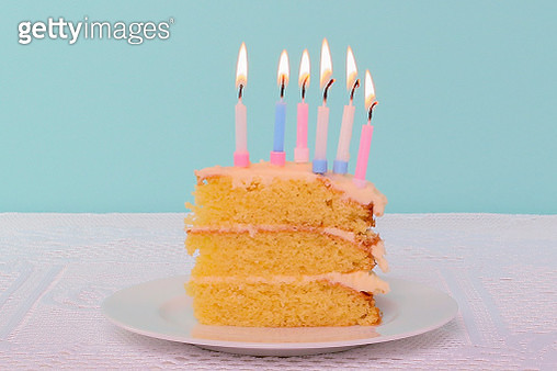 Birthday Cake In Plate Against Blue Background On Table - gettyimageskorea
