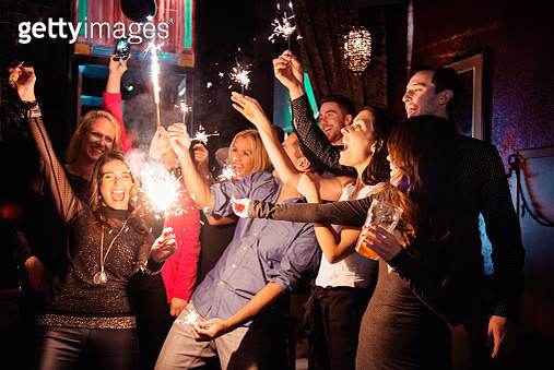 New Years Eve in a bar between coworkers and colleagues. - gettyimageskorea