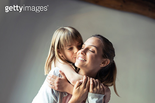 Mother and daughter playing at home, piggyback - gettyimageskorea