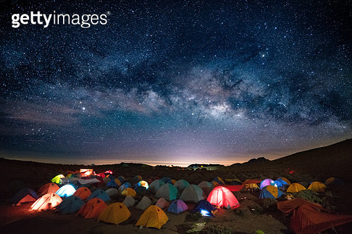 Camping in a Tent Under the Stars and Milky Way Galaxy - gettyimageskorea