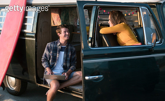 Young couple on a road trip together in their vintage van - gettyimageskorea