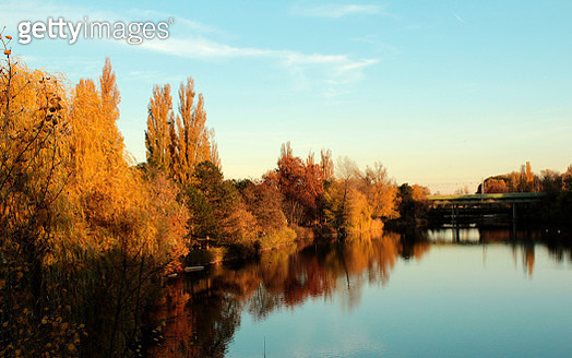 Scenic View Of Lake By Trees Against Sky During Autumn - gettyimageskorea