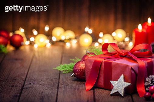 Red Christmas gift box on rustic wooden table - gettyimageskorea