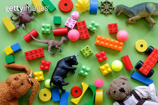 High Angle View Of Toys Over Green Background - gettyimageskorea