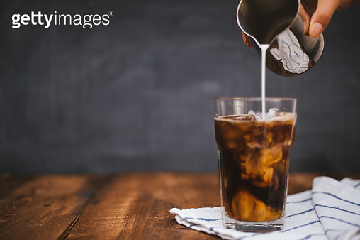 Iced Latte on wooden table - gettyimageskorea