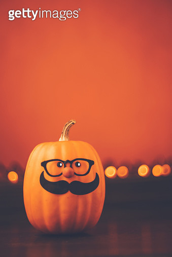 Halloween background with cute mustached pumpkin character - gettyimageskorea