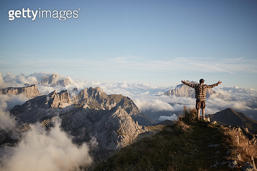Man on top of mountain - gettyimageskorea