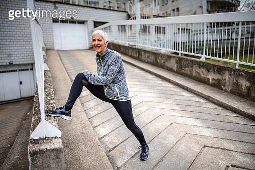 Mature woman stretching. - gettyimageskorea