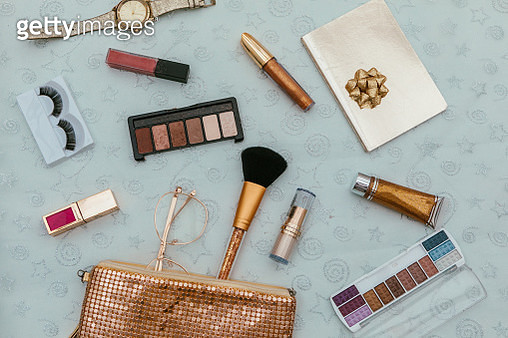 Women's fashion.  handbag, makeup brushes on golden background. magazines, social media. Top view. Flat lay. - gettyimageskorea