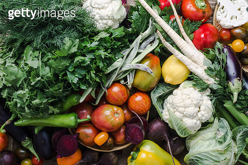Fresh local vegetables and herbs, colorful variety, plant based food,  homegrown crop viewed from above. - gettyimageskorea