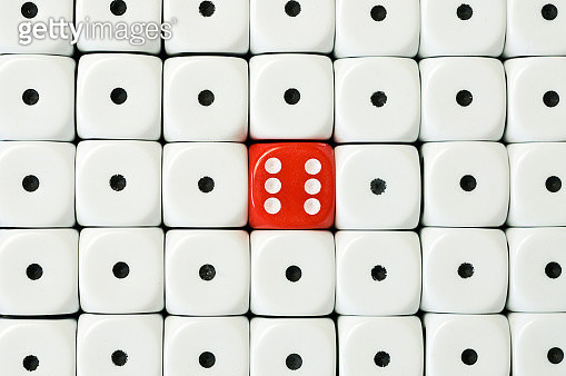Red six dice surrounded by white dice - gettyimageskorea