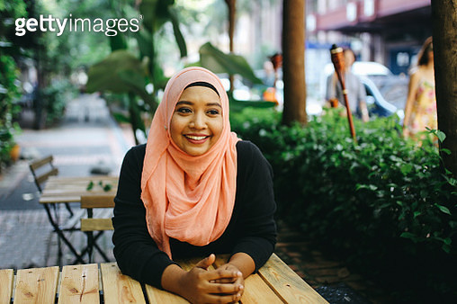 Portrait of a Malaysian woman on the cafe in Kuala Lumpur - gettyimageskorea
