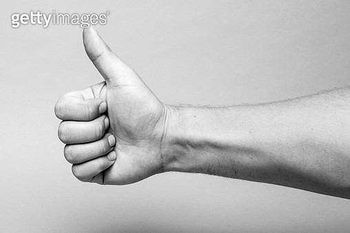 Cropped Image Of Hand With Thumb Up Against Wall - gettyimageskorea