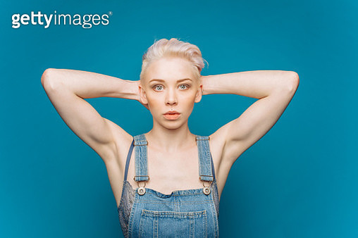 Portrait of woman with short blonde hair on blue background - gettyimageskorea