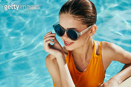 Woman smiling in beautiful glasses in the pool - gettyimageskorea