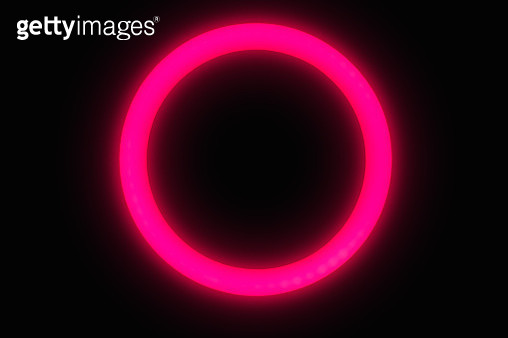 Red circle neon light glowing at night wit black background. - gettyimageskorea