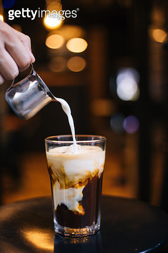 Pouring milk in iced Latte - gettyimageskorea