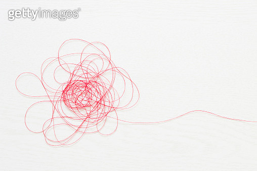 Red thread on white background - gettyimageskorea