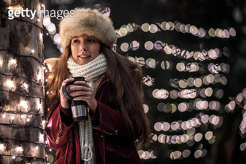 Enjoying the glowing lights during winter at the Christmas market - gettyimageskorea