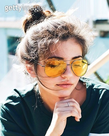 Close-Up Of Young Woman Wearing Yellow Sunglasses Outdoors - gettyimageskorea