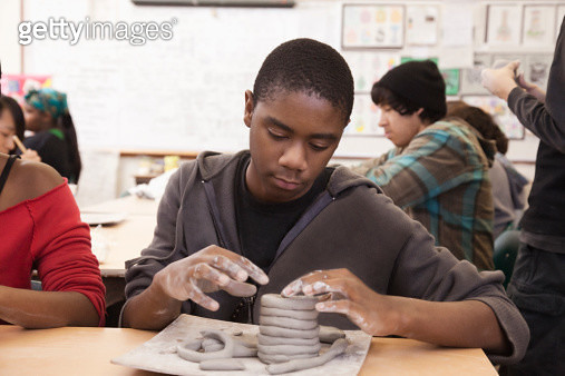 Student working with clay in classroom - gettyimageskorea