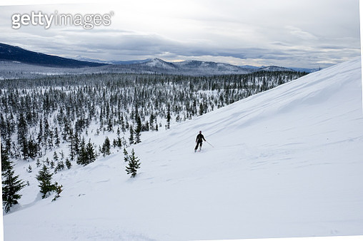 High Angle View Of Man Skiing On Snowcapped Mountain - gettyimageskorea