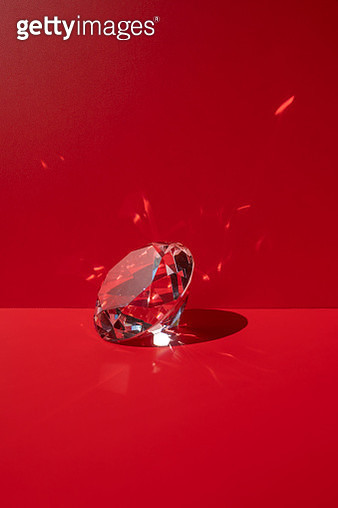One shiny diamond on the red background - gettyimageskorea