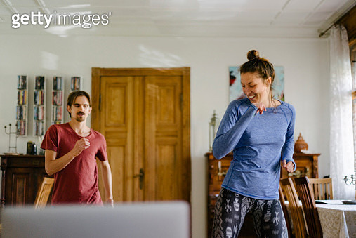 Young Couple Keeping Fit At Home Together - gettyimageskorea