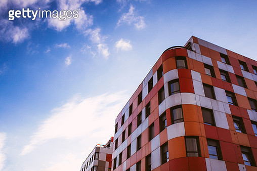 Colorful residential building against sky - gettyimageskorea