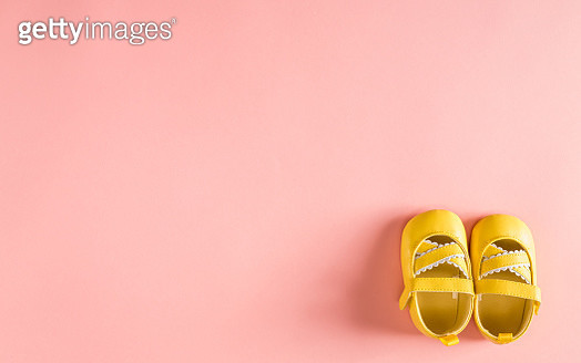 Baby shoes on a pink background - gettyimageskorea