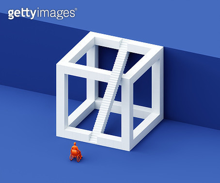 Man in wheelchair in front of impossible cube - gettyimageskorea