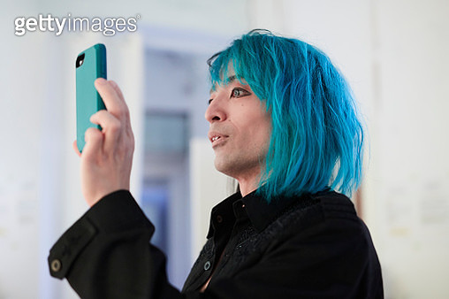 Unique male dancer with dyed hair - gettyimageskorea