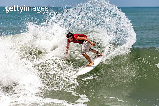Surfing in the Pacific Ocean - gettyimageskorea