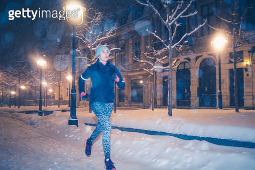 Jogging at snow, urban environment - gettyimageskorea