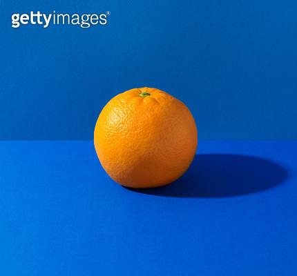 Orange on blue background - gettyimageskorea