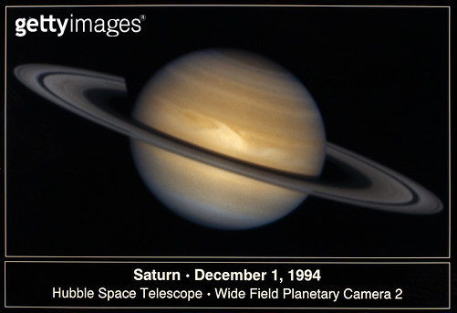 SATURN, 1994. /nA composite of photographs of Saturn taken by NASA's Hubble Space Telescope, 1 December 1994, showing a storm system equal to the Earth's diameter (about 7,900 miles) near the equator, in the form of a white arrowhead. - gettyimageskorea