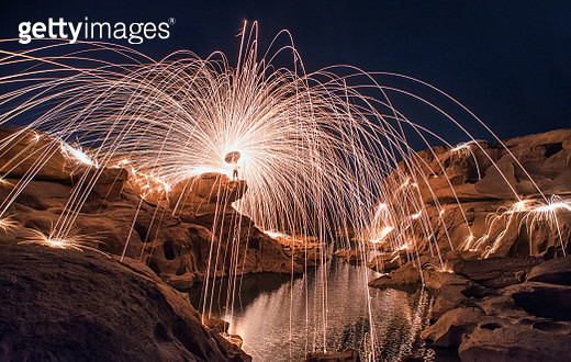 Spinning fire at the rock canyon - gettyimageskorea