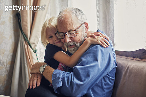 Happy smiling granddaughter hugging her grandfather - gettyimageskorea
