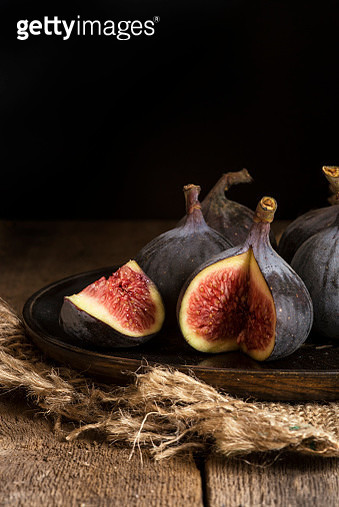 Fresh figs in moody natural lighting set with vintage retro styl - gettyimageskorea