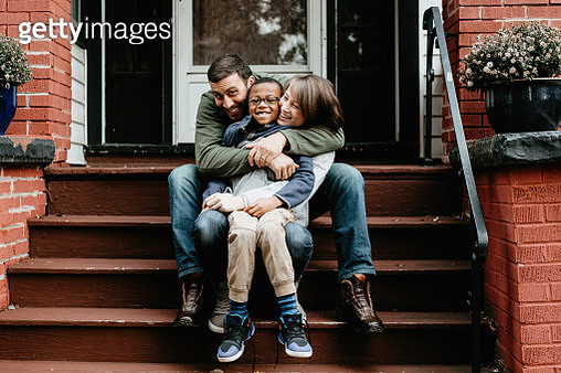 Multi racial family photos with adoptive son big hug - gettyimageskorea