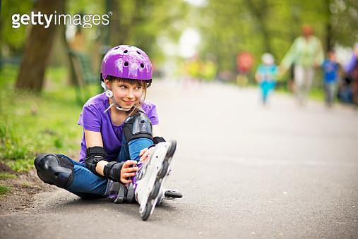 Little girl rollerskating in park - gettyimageskorea
