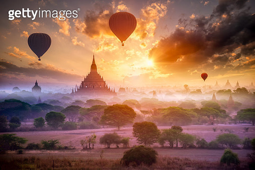 Hot air balloon over plain of Bagan in misty morning, Mandalay, Myanmar - gettyimageskorea