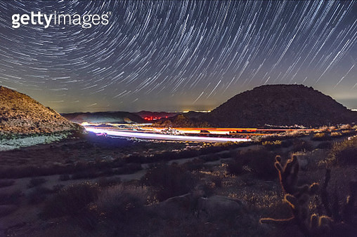Star Trails, Freeway Traffic, and Mountains. Interstate 8 and Remains of Old Highway 80 at Night. - gettyimageskorea
