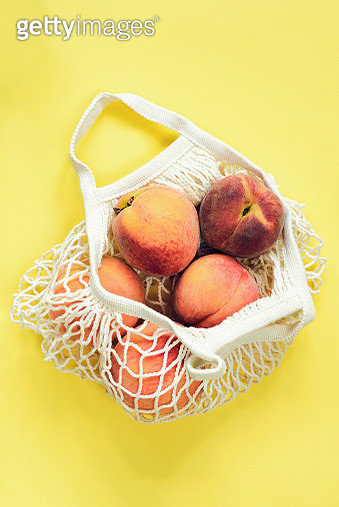 Mesh shopping bag with peaches - gettyimageskorea