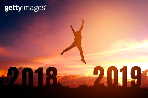 Silhouette Person Jumping Amidst Numbers On Field Against Orange Sky - gettyimageskorea
