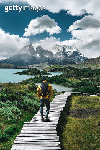 man hiking at torres del paine - chile - gettyimageskorea