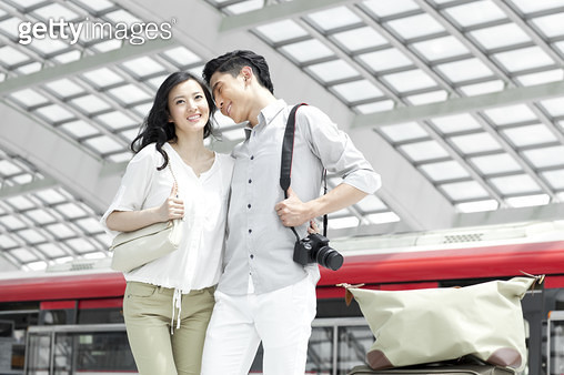 Young couple at subway station - gettyimageskorea