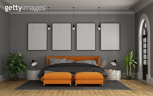 Empty Bed Against Blank Frames On Wall In Bedroom At Home - gettyimageskorea